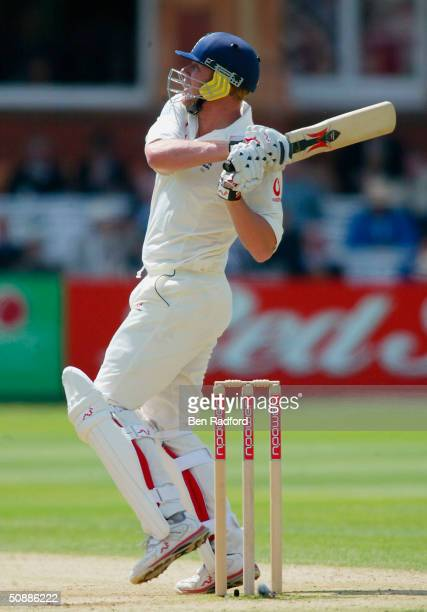 Andrew Flintoff of England hits out on his way to making fifty runs during the third day of the first npower test match between England and New...