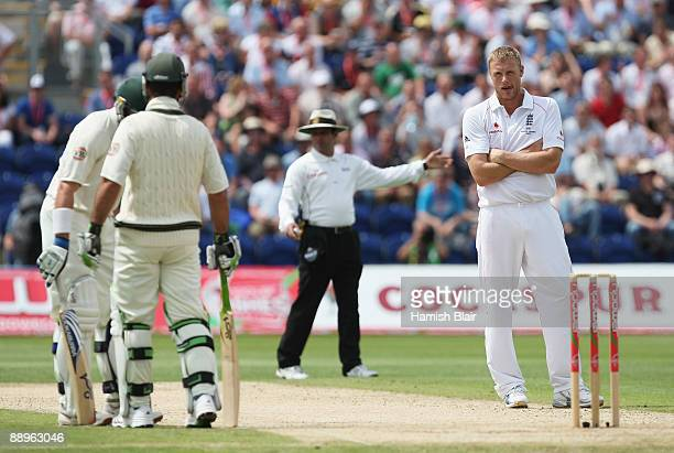 Andrew Flintoff of England looks dejected after he was hit for six runs by Ricky Ponting of Australia during day three of the npower 1st Ashes Test...