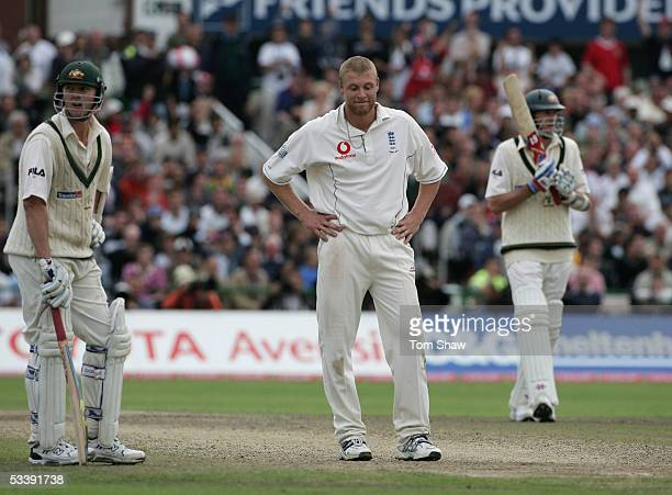 Andrew Flintoff of England looks dejected as Brett Lee and Glenn McGrath of Australia look on during day five of the Third npower Ashes Test match...