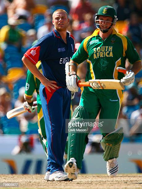 Andrew Flintoff of England looks on as Graeme Smith of South Africa runs between the wickets during the ICC Cricket World Cup Super Eights match...