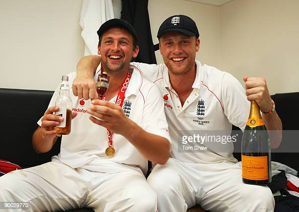 Andrew Flintoff of England poses with Steve Harmison and the Ashes urn in the dressing room after day four of the npower 5th Ashes Test Match between...