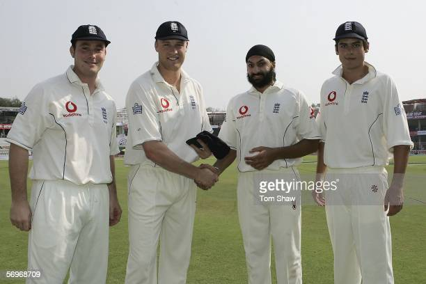 Andrew Flintoff of England presents new caps to Ian Blackwell , Mony Panesar and Alastair Cook during day one of the First Test between India and...