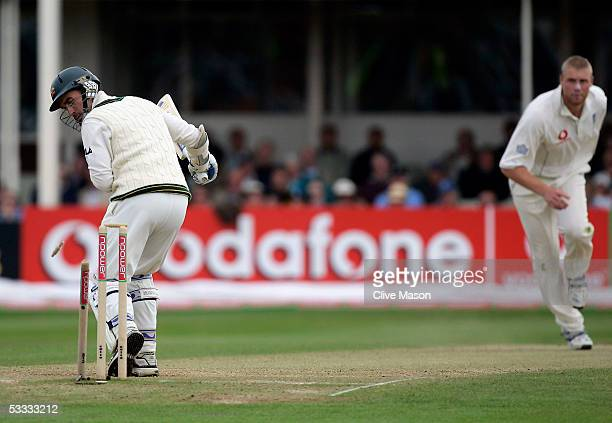 Andrew Flintoff of England takes the wicket of Justin Langer of Australia during day three of the second npower Ashes Test match between England and...