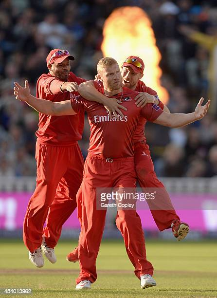 Andrew Flintoff of Lancashire celebrates with Ashwell Prince and Paul Horton after dismissing Ian Bell of Birmingham Bears during the Natwest T20...