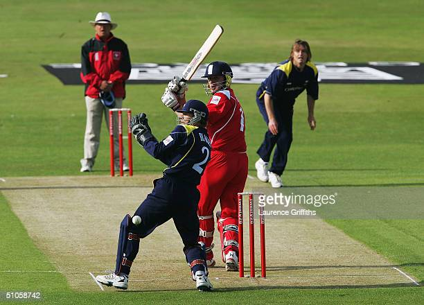 Andrew Flintoff of Lancashire clips the ball past Richard Blakey of Yorkshire during the Twenty20 Cup match between Yorkshire Phoenix and the...