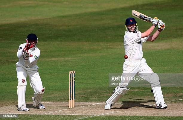 Andrew Flintoff of Lancashire hits out on his way to 50 as wicketkeeper Matt Prior of Sussex looks on during the LV County Championship match between...