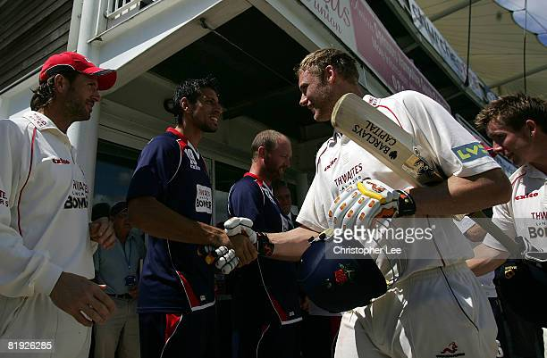 Andrew Flintoff of Lancashire is congratulated by his team mates after winning their match during Day 4 of the LV County Championship match between...