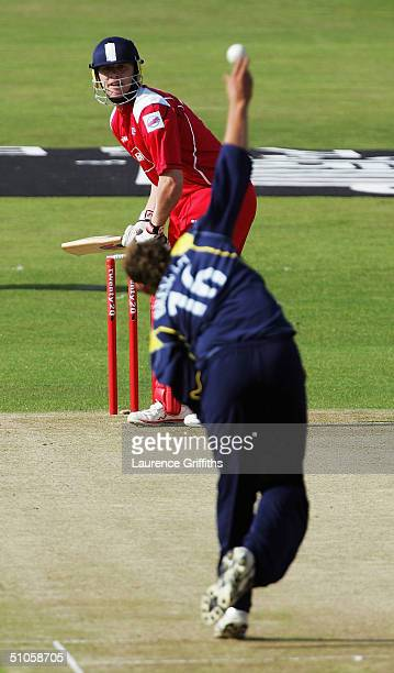 Andrew Flintoff of Lancashire keeps a watchful eye on the ball from the hand of Tim Bresnan of Yorkshire during the Twenty20 Cup match between...