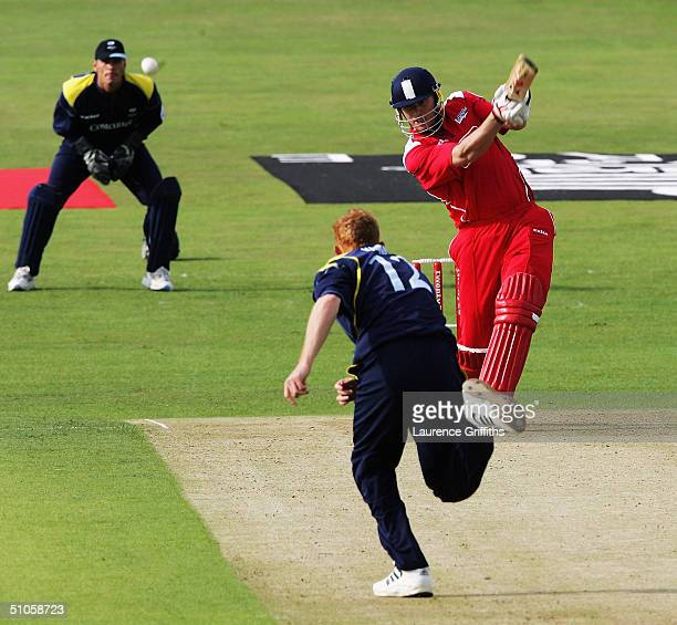 Andrew Flintoff of Lancashire smashes the ball to the boundary of the bowling of Steve Kirby of Yorkshire during the Twenty20 Cup match between...