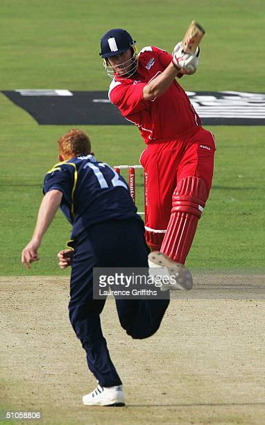 Andrew Flintoff of Lancashire smashes the ball to the boundary off the bowling of Steve Kirby of Yorkshire during the Twenty20 Cup match between...