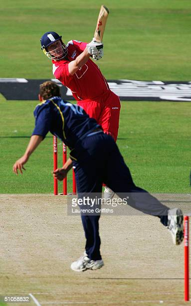Andrew Flintoff of Lancashire smashes the ball to the boundary off the bowling of Tim Bresnan of Yorkshire during the Twenty20 Cup match between...