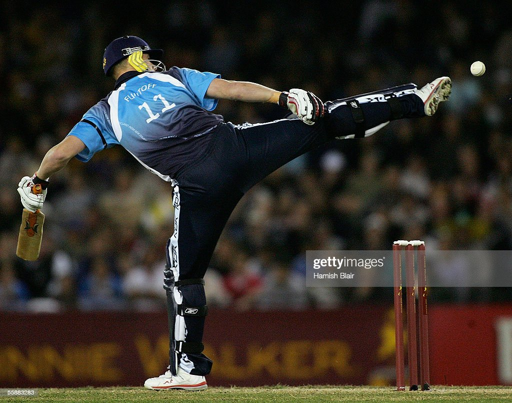 Andrew Flintoff of the ICC World XI attempts to kick the ball clear of his stumps during Game Three of the Johnnie Walker Super Series between Australia and the ICC World XI played at the Telstra Dome on October 9, 2005 in Melbourne, Australia.
