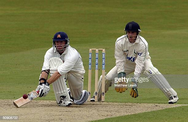 Andrew Flower of Essex plays a reverse sweep as Chris Read of Nottinghamshire looks on during the Cheltenham and Gloucester Trophy match between...