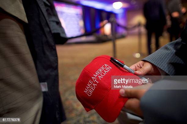 Andrew Ford holds a Make America Great Again hat for an autograph before Republican Presidential nominee Donald J Trump holds an event at the...