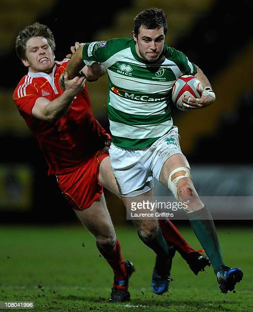Andrew Forsyth of Nottingham breaks past Ivan Dineen of Munster during the British and Irish Cup match between Nottingham and Munster at Meadow Lane...