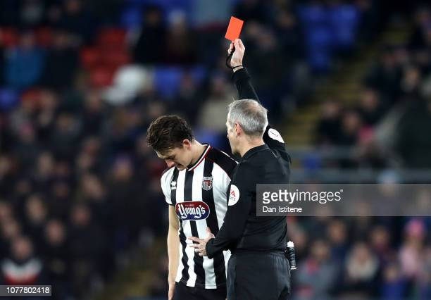 Andrew Fox of Grimsby Town is sent off by referee Mark Atkinson during the FA Cup Third Round match between Crystal Palace and Grimsby Town at...