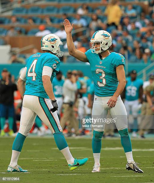 Andrew Franks and Matt Darr of the Miami Dolphins celebrate a field goal during a game against the New York Jets at Hard Rock Stadium on November 6...