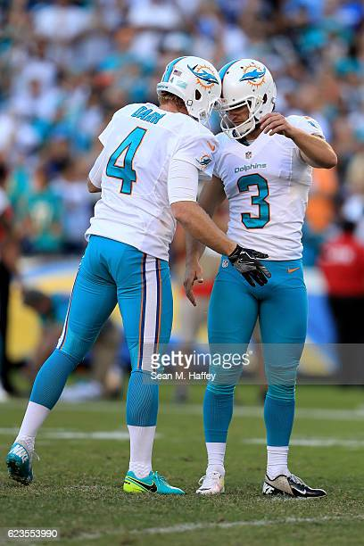 Andrew Franks and Matt Darr of the Miami Dolphins react after a fieldgoal during a game against the Miami Dolphins at Qualcomm Stadium on November 13...