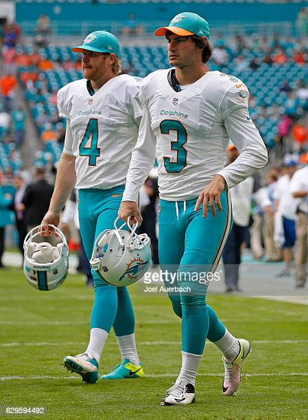 Andrew Franks and Matt Darr of the Miami Dolphins take the field prior to the game against the Arizona Cardinals on December 11 2016 at Hard Rock...