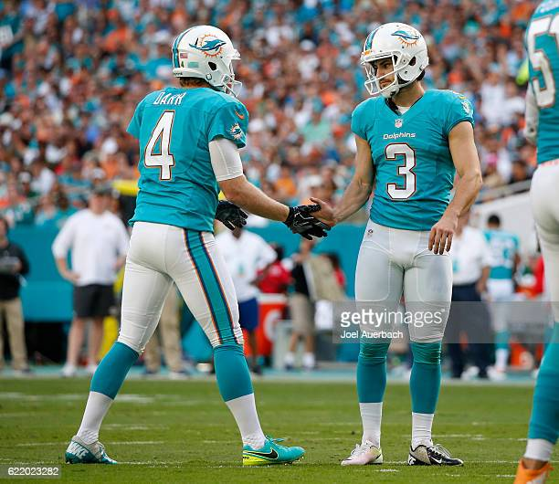 Andrew Franks is congratulated by Matt Darr of the Miami Dolphins after kicking a field goal against the New York Jets on November 6 2016 at Hard...