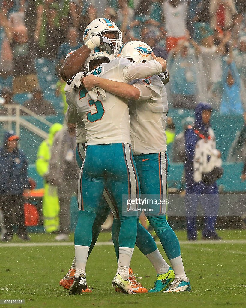 Andrew Franks #3 of the Miami Dolphins celebrates a game winning field goal during a game against the Arizona Cardinals at Hard Rock Stadium on December 11, 2016 in Miami Gardens, Florida.