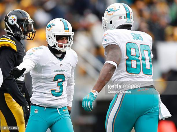 Andrew Franks of the Miami Dolphins celebrates after kicking a field goal during the second quarter against the Pittsburgh Steelers in the AFC Wild...