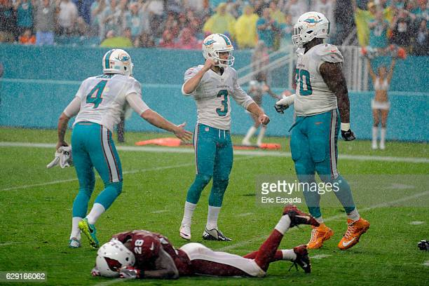 Andrew Franks of the Miami Dolphins celebrates after kicking the game winning field goal against the Arizona Cardinals at Hard Rock Stadium on...