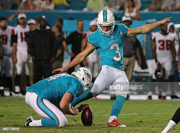Andrew Franks of the Miami Dolphins kicks a field goal during a preseason game against the Atlanta Falcons at Sun Life Stadium on August 29 2015 in...