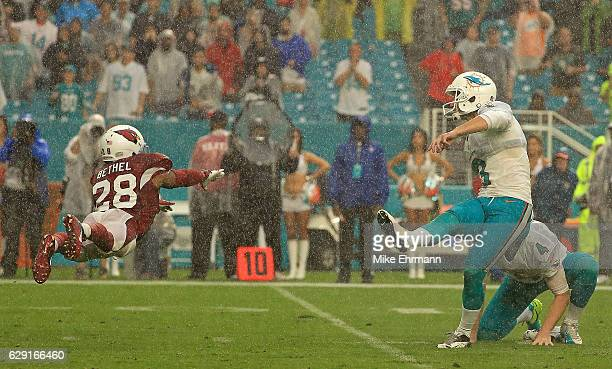 Andrew Franks of the Miami Dolphins kicks a game winning field goal during a game against the Arizona Cardinals at Hard Rock Stadium on December 11...