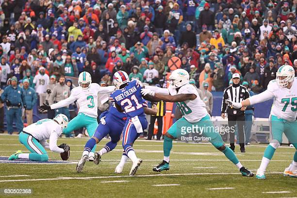 Andrew Franks of the Miami Dolphins kicks the game tying field goal against the Buffalo Bills in overtime at New Era Stadium on December 24 2016 in...