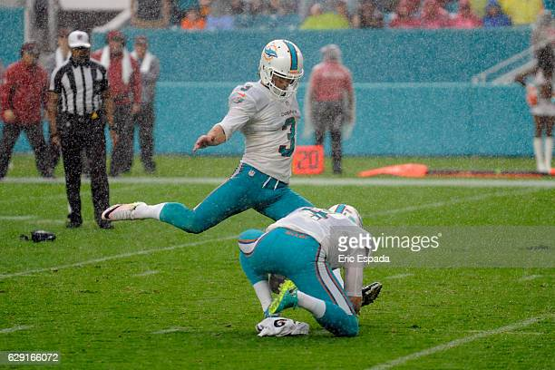 Andrew Franks of the Miami Dolphins kicks the game winning field goal against the Arizona Cardinals at Hard Rock Stadium on December 11 2016 in Miami...