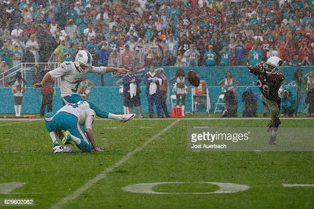 Andrew Franks of the Miami Dolphins kicks the game winning field goal with one second on the clock as Justin Bethel of the Arizona Cardinals is...