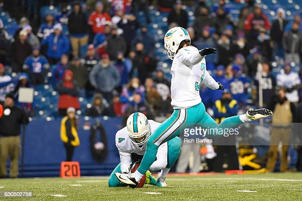 Andrew Franks of the Miami Dolphins kicks the game winning field goal against the Buffalo Bills in overtime at New Era Stadium on December 24 2016 in...