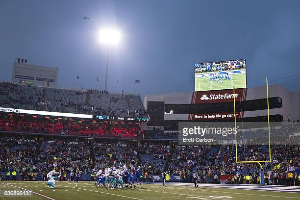 Andrew Franks of the Miami Dolphins kicks the game winning field goal during overtime to defeat the Buffalo Bills on December 24 2016 at New Era...