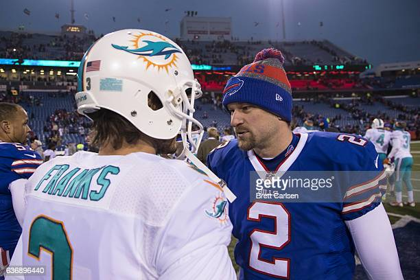 Andrew Franks of the Miami Dolphins shakes hands with Dan Carpenter of the Buffalo Bills after the game on December 24 2016 at New Era Field in...