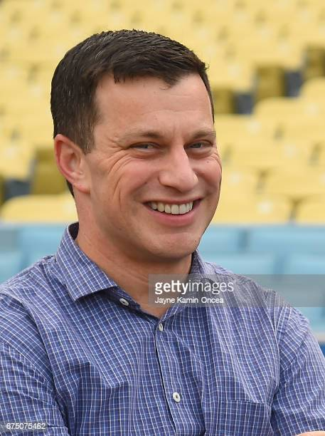 Andrew Friedman Los Angeles Dodgers President of Baseball Operations watches batting practice before the game against the Philadelphia Phillies at...
