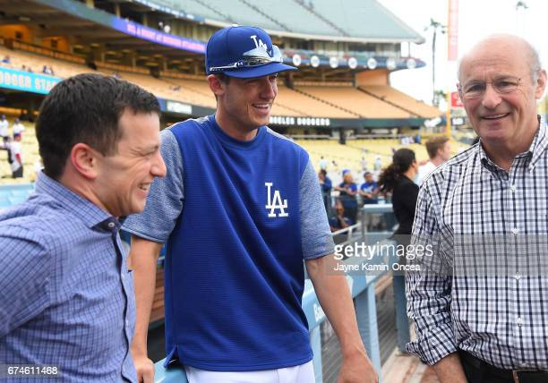 Andrew Friedman President of Baseball Operations and Stan Kasten President and partowner of the Los Angeles Dodgers talk with Cody Bellinger of the...