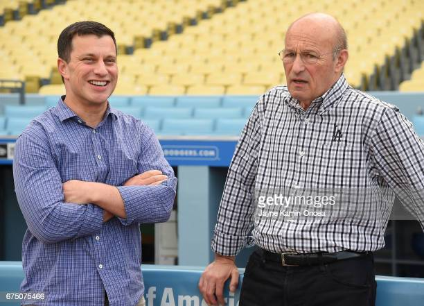 Andrew Friedman President of Baseball Operations and Stan Kasten president and partowner of the Los Angeles Dodgers talk before the game against the...