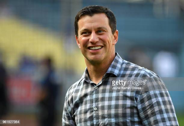 Andrew Friedman President of Baseball Operations for the Los Angeles Dodgers walks on the field before the game against the Colorado Rockies at...