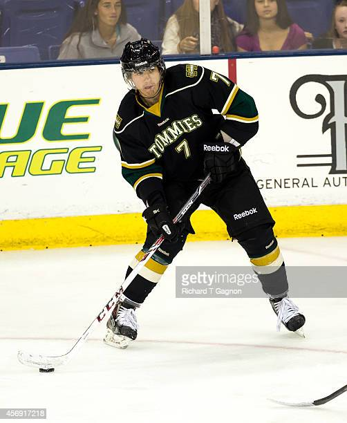 Andrew Fritsch of the St. Thomas University Tommies controls the puck against the Massachusetts Lowell River Hawks during NCAA exhibition hockey at...
