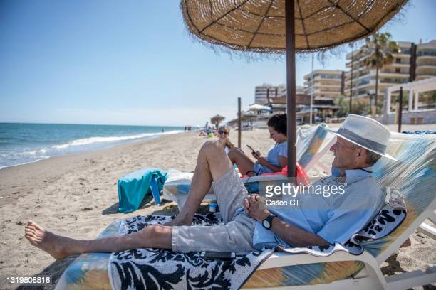 Andrew from the United Kingdom, who is also a resident in Spain, lays on a deck chair on the beach on May 24, 2021 in Fuengirola, Spain. From today,...