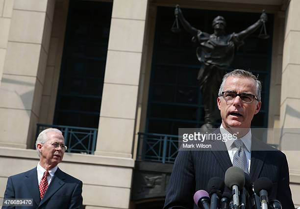 Andrew G McCabe Assistant Director of the FBI's Washington Field Office speaks while flanked by Dana J Boente US Attorney for the Eastern District of...