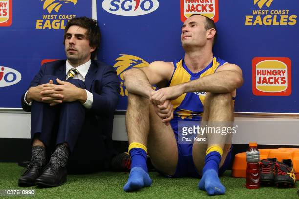 Andrew Gaff and Shannon Hurn of the Eagles look on in the change rooms following the AFL Preliminary Final match between the West Coast Eagles and...
