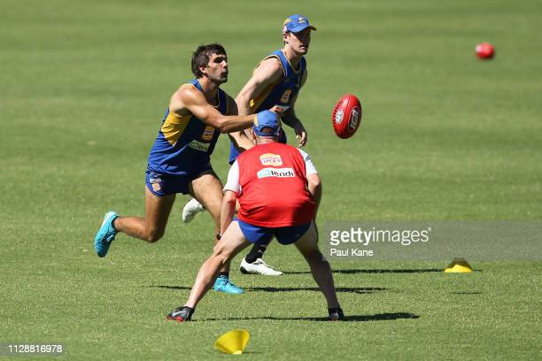 Andrew Gaff handballs during a West Coast Eagles AFL training session at Lathlain Park on February 11 2019 in Perth Australia