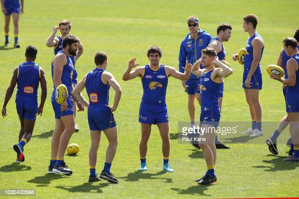 Andrew Gaff interacts with team mates during a West Coast Eagles AFL training session at Subiaco Oval on September 10 2018 in Perth Australia