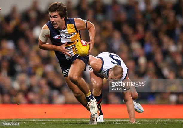 Andrew Gaff of the Eagles breaks clear of Scott Thompson of the Crows during the round 15 AFL match between the West Coast Eagles and the Adelaide...