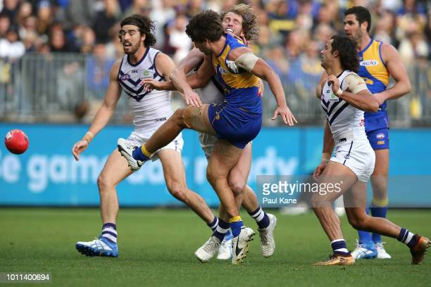 Andrew Gaff of the Eagles gets his kick away while being tackled by David Mundy of the Dockers during the round 20 AFL match between the West Coast...