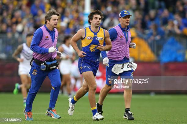Andrew Gaff of the Eagles is assisted from the field during the round 20 AFL match between the West Coast Eagles and the Fremantle Dockers at Optus...