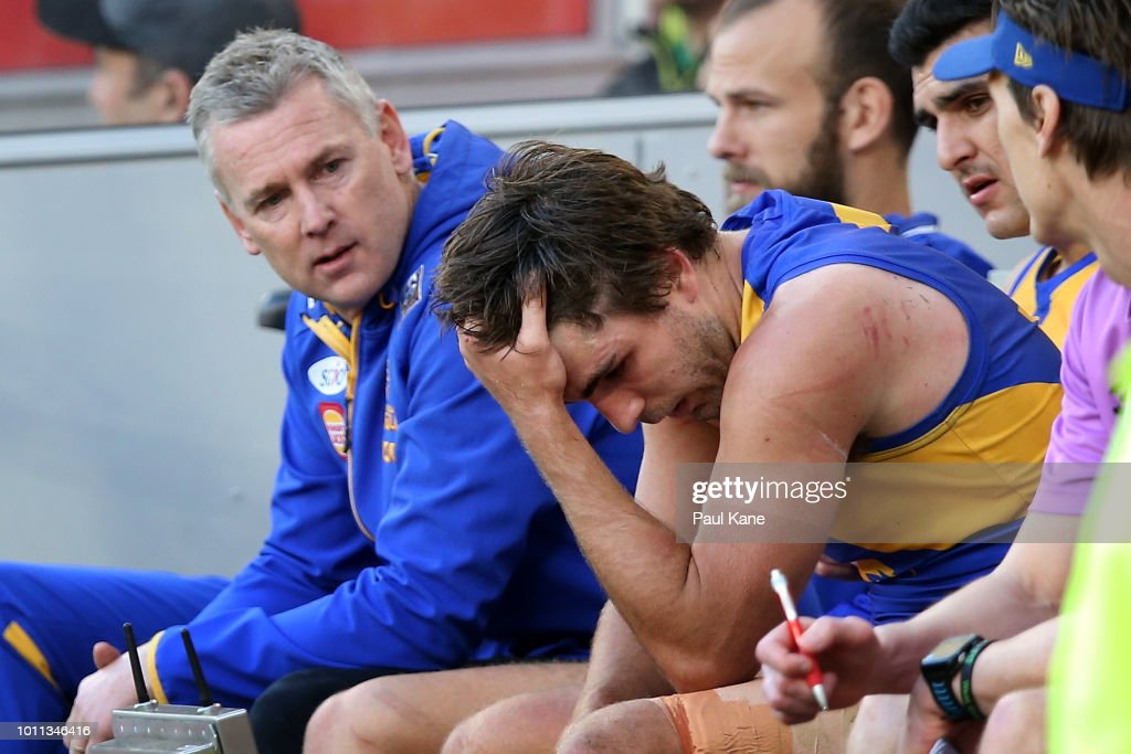 Andrew Gaff of the Eagles looks dejected sitting on the bench during the round 20 AFL match between the West Coast Eagles and the Fremantle Dockers at Optus Stadium on August 5, 2018 in Perth, Australia.
