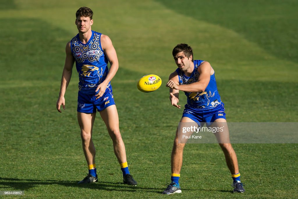 Andrew Gaff works on a handball drill with Jack Redden during a West Coast Eagles AFL training session at Subiaco Oval on May 29, 2018 in Perth, Australia.